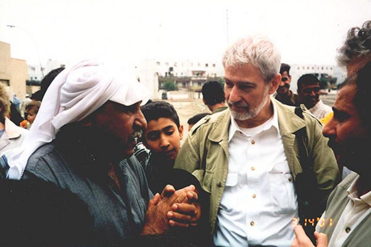 Fr. Woods with Iraqi citizens in 2001